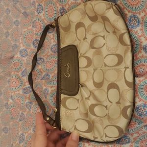 Coach large wristlet with rose gold and tan Cs
